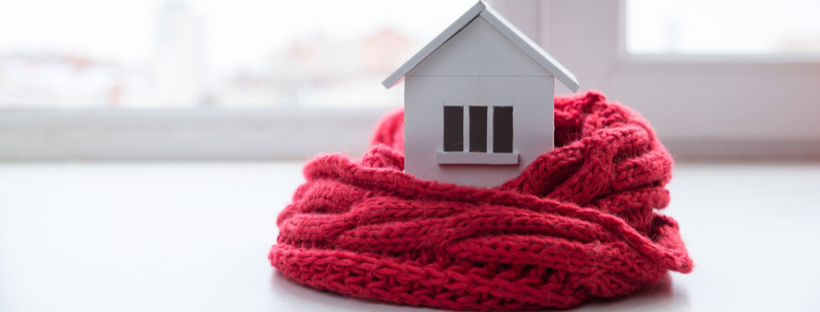 Toy house wrapped in a woolen scarf